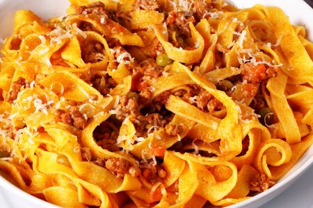 Fettuccine with Bolognese meat sauce. Traditional dish of Italian cuisine.