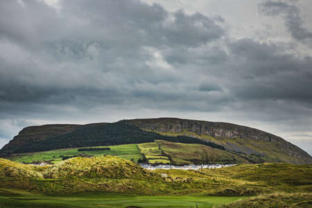 Knocknarea hill with the Queen Maeve Trail: a foot path which leads you on top of it. Knocknarea is also symbolic, limestone mountain that dominates the skyline of Sligo near Strandhill, Ireland