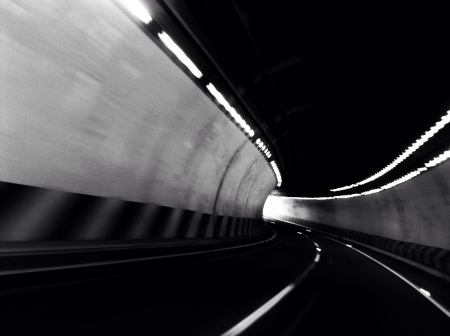 curve: In the middle of a curve in a road tunnel.
