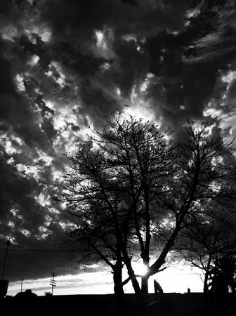 light path between dramatic fleecy clouds.