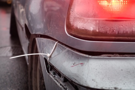 car bumper mounted with z zip tie, during racing event in Poland