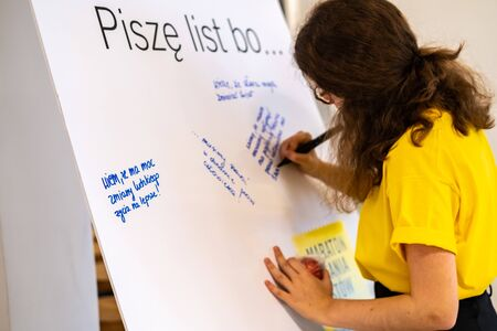 Warsaw  Poland - December 9, 2018: Write for Rights is the worlds biggest human rights event organized by Amnesty International. Over 200 000 letters are sent from Poland every year to those, whose human rights are being attacked. This young woman is