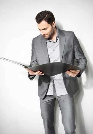 Portrait of a handsome business man ,Isolated on gray Stock Photo - 18462311