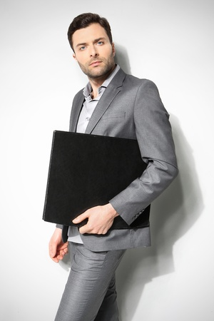 Portrait of a handsome business man ,Isolated on gray Stock Photo - 18462314