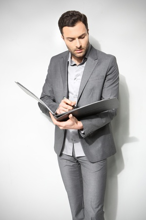 Portrait of a handsome business man ,Isolated on gray Stock Photo - 18453254