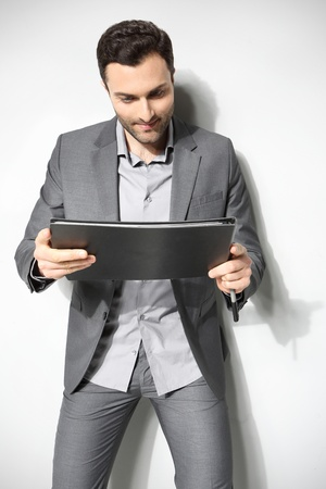 Portrait of a handsome business man ,Isolated on gray Stock Photo - 18462349