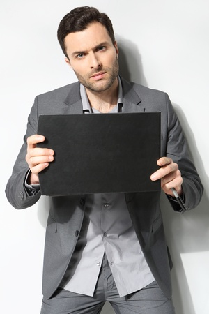 Portrait of a handsome business man ,Isolated on gray Stock Photo - 18453382
