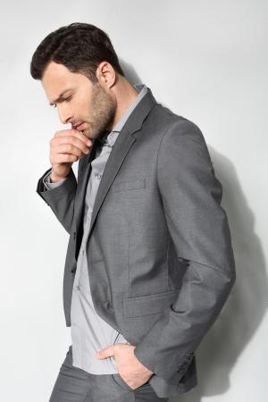 Young stylish man on a gray background 版權商用圖片