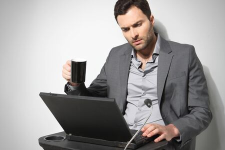 Young businessman working on is laptop photo