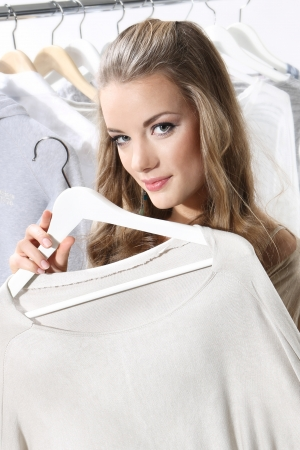 Pretty girl trying on clothes Stock Photo - 18493288