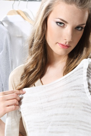 Pretty girl trying on clothes Stock Photo - 18493300