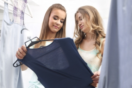 Two pretty girls choosing clothes Stock Photo - 18497442