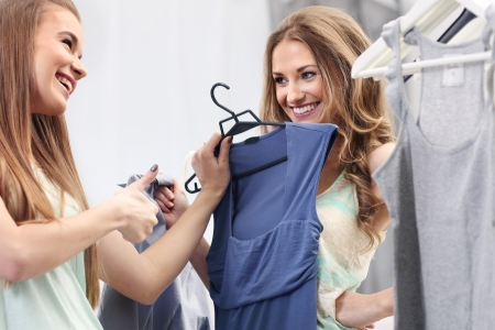 Two pretty girls choosing clothes photo
