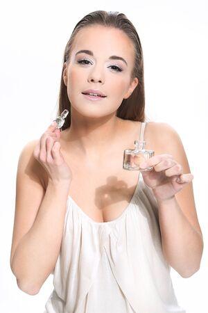 Portrait of beautiful woman holding perfume on white background Stock Photo - 18498269