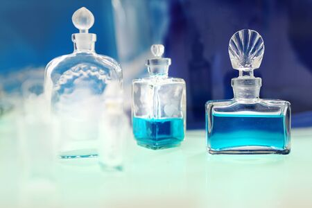 Perfume with beautiful bottle on the table Stock Photo - 18517381