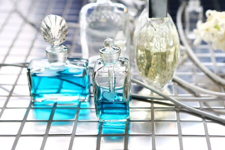 Perfume with beautiful flowers on the table Stock Photo - 18517322