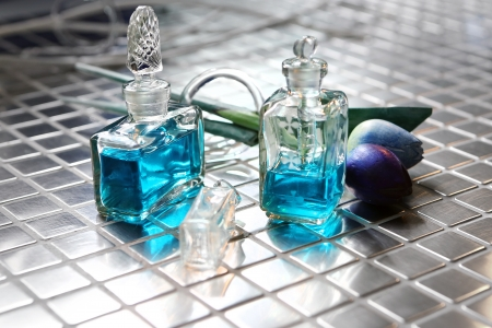 Perfume with beautiful flowers on the table Stock Photo - 18517332