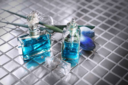 Perfume with beautiful flowers on the table Stock Photo - 18517415