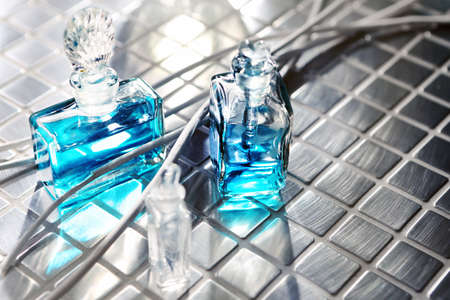 Perfume with beautiful flowers on the table Stock Photo - 18517418