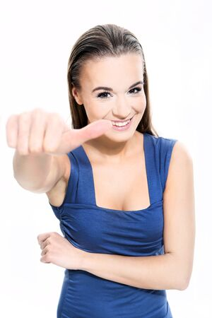 Beautiful girl shows a sign on a white background Stock Photo - 18498131