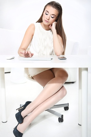 Girl working at a computer in the office Stock Photo - 18498133