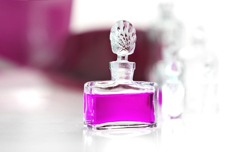 Perfume on a white table Stock Photo - 18517313
