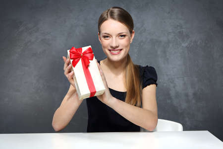 Girl holding a box with a gift Stock Photo - 18497714