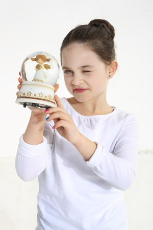 Little girl holding glass angel figurine  Stock Photo - 18498864