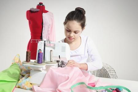 Portrait of little seamstress photo