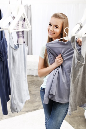 Pretty girl trying on clothes Stock Photo - 18498848