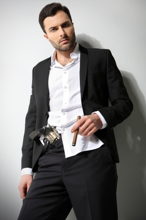 Man Holding a fire gun and smoking a cigar photo
