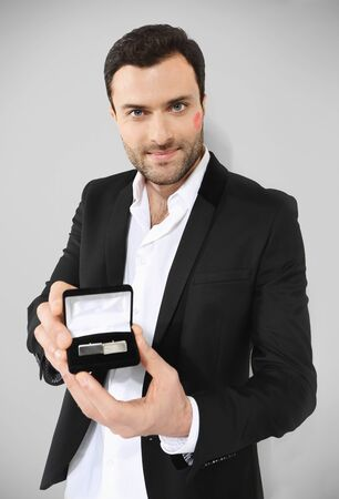 shiny buttons: Attractive man holding black box with cufflinks