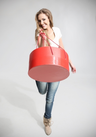 Beautiful girl holding a red and round box Stock Photo - 18570561