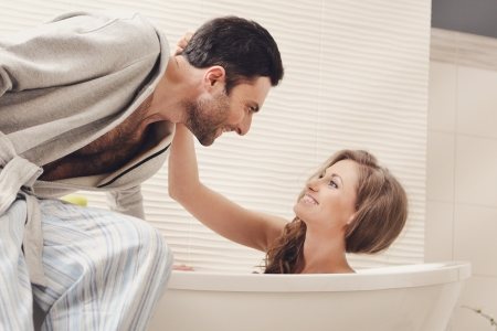 Young beautiful couple in the bathroom photo