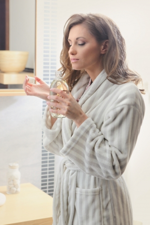 Beautiful woman smelling her perfume  photo