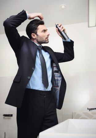 Young handsome businessman makes hair photo