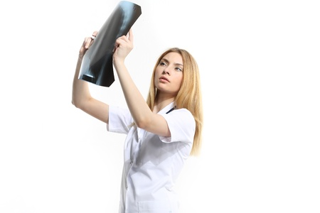 Female doctor examining an x-ray isolated on white background  photo