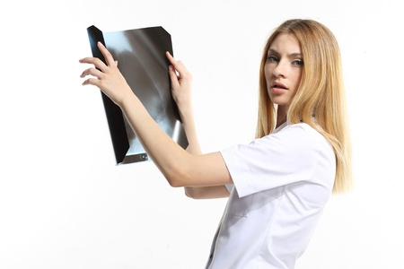 Female doctor examining an x-ray isolated on white background  Stock Photo - 22064123