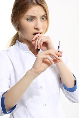 Female doctor with syringe photo