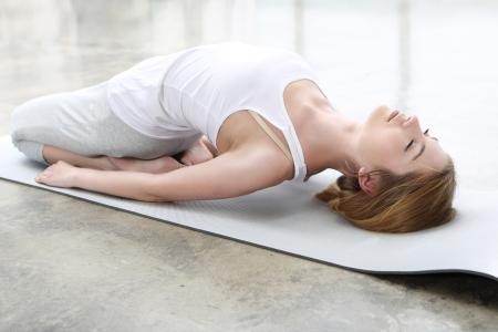 Pregnant woman doing yoga exercise photo