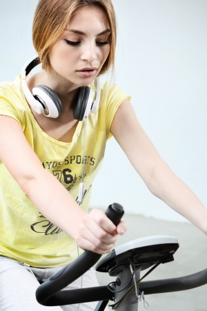 Young girl on stationary bike photo