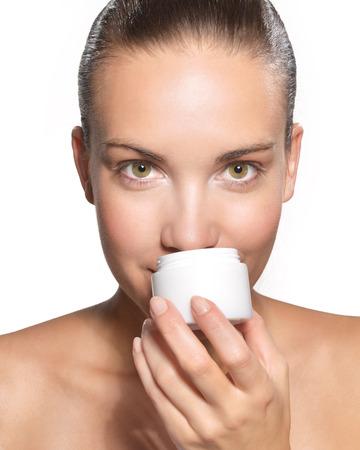 beautiful woman smelling cream Stock Photo - 22610884