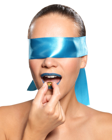 Sexy blindfolded woman blowing a feather Stock Photo - 22610885