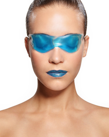 Woman in a blue gel mask photo