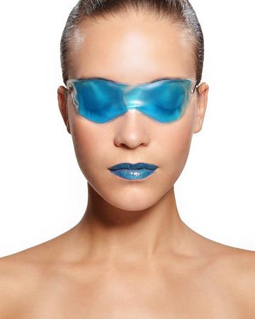 brown hair blue eyes: Woman in a blue gel mask Stock Photo