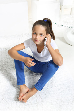 sister: girl talking on cell phone Stock Photo