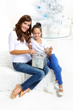happy mom and daughter with Christmas gift photo