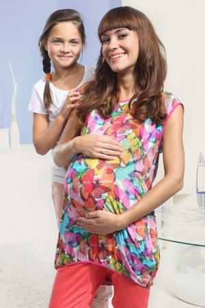 happy expectant mother and older daughter Stock Photo - 22448630