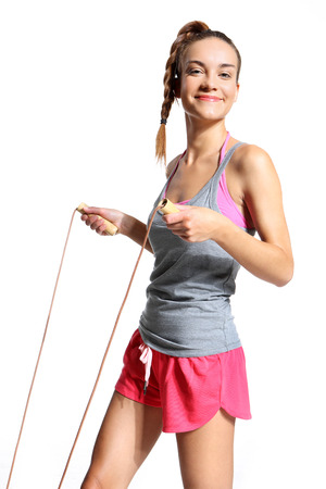 happy woman exercising with a jump rope photo