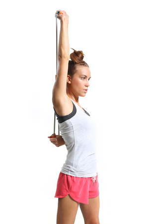 athletic woman stretching back muscles training with rubber photo